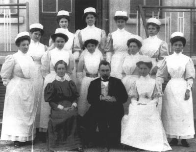 The Depages and Edith Cavell with their staff of nurses.